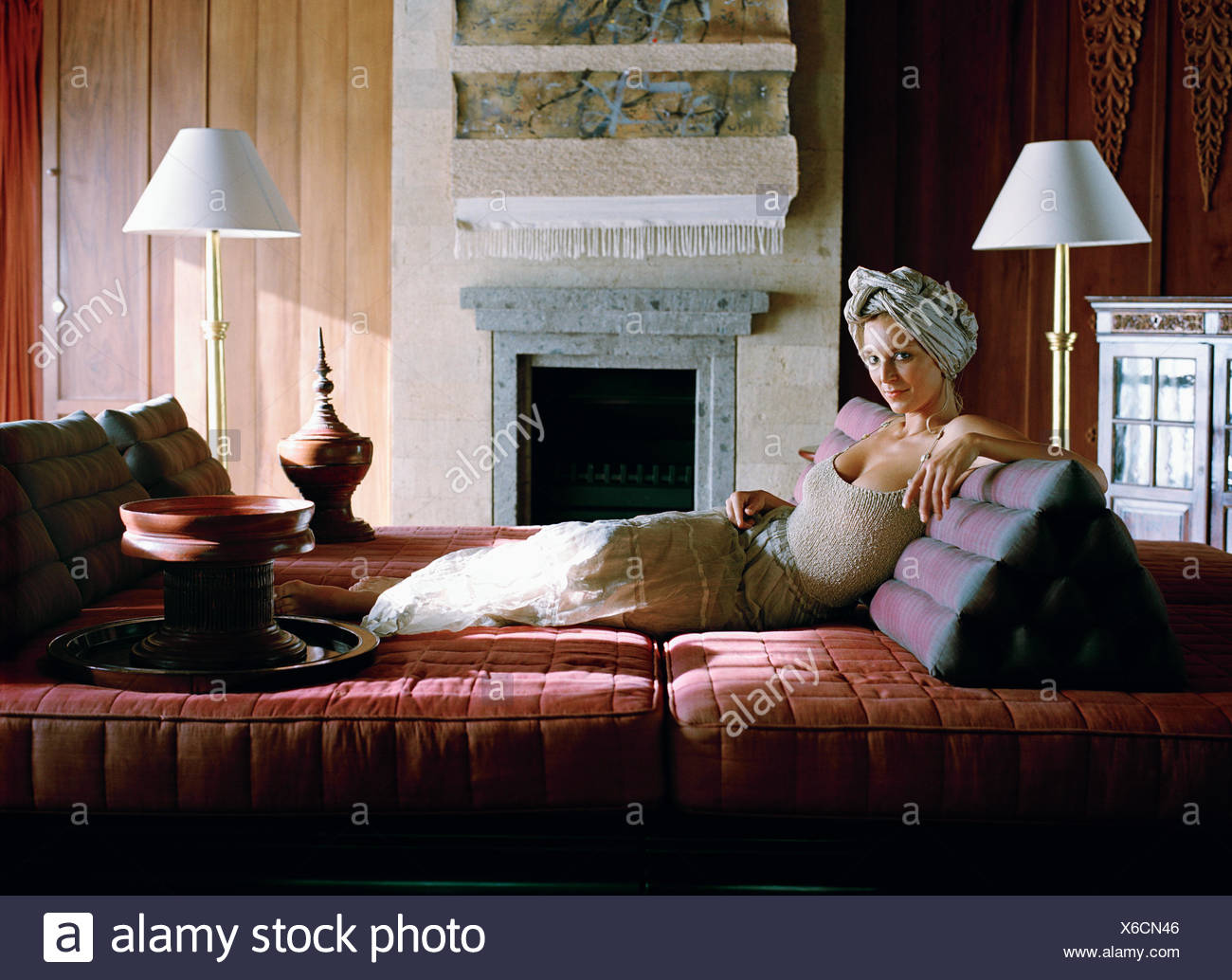 A Scandinavian woman on a couch. - Stock Image