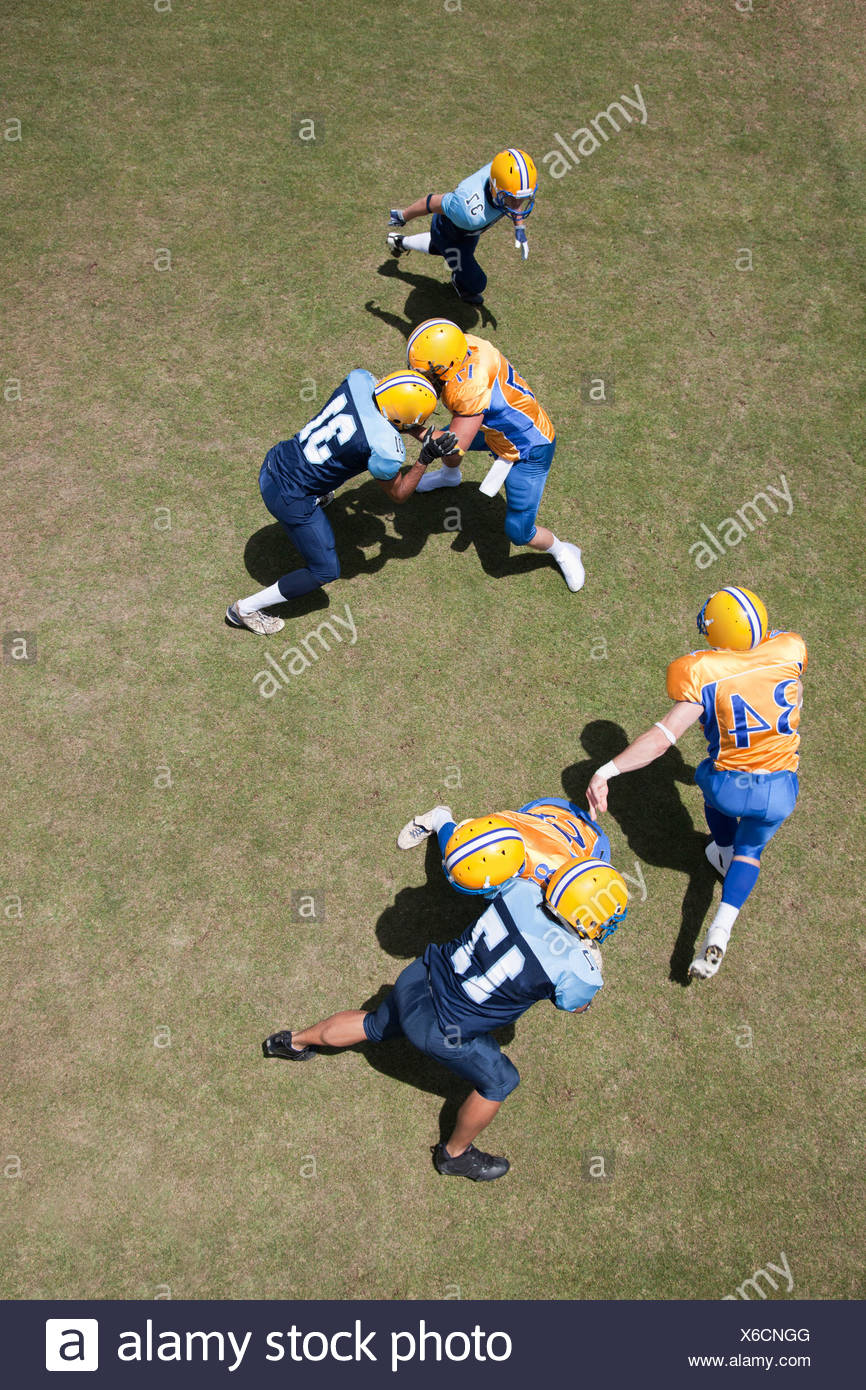 Football players playing football - Stock Image