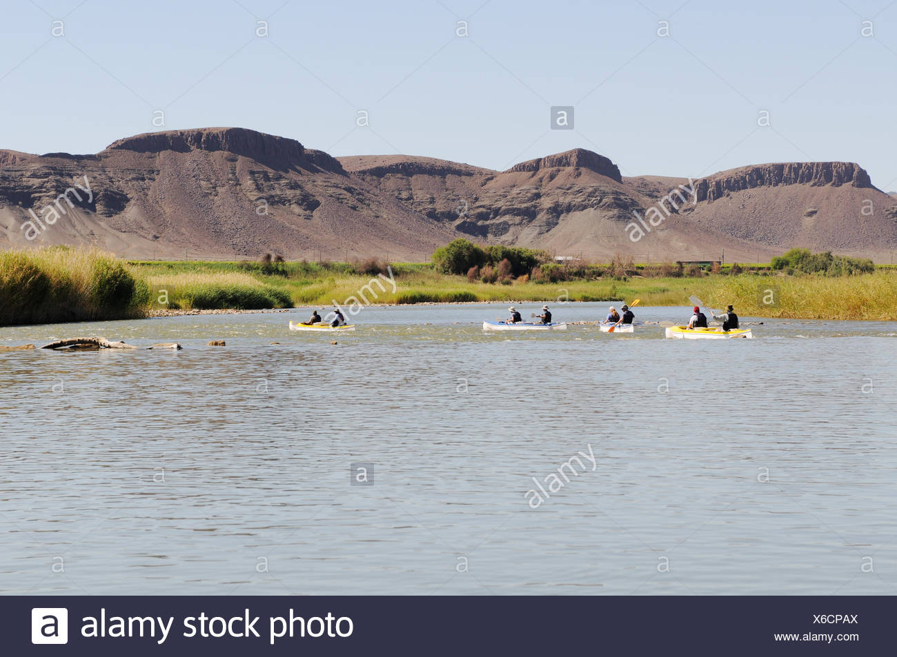 Canoe trip on the Oranje, Orange River, border river between Namibia and South Africa - Stock Image