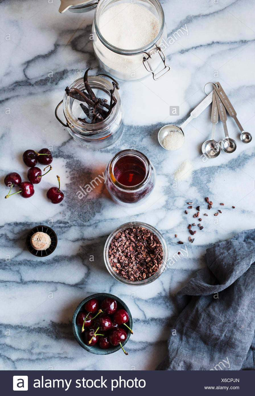 Ingredients for a cherry soda cocktail. - Stock Image