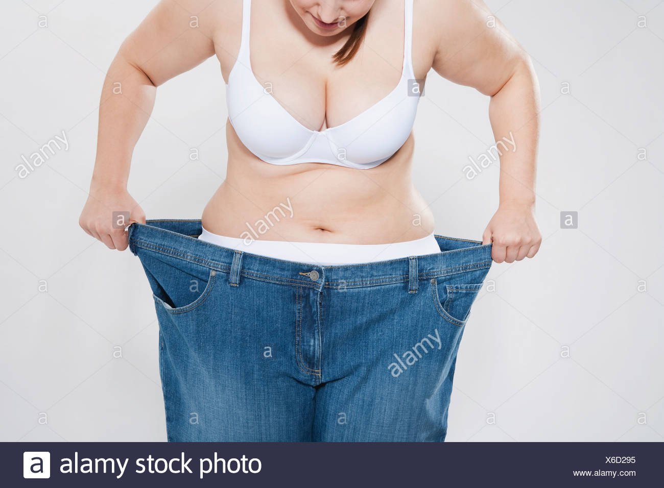 Young chubby woman with oversized pant - Stock Image