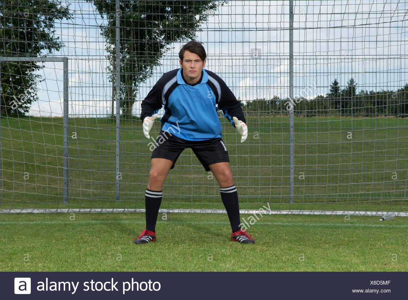 Goalkeeper standing in goal - Stock Image