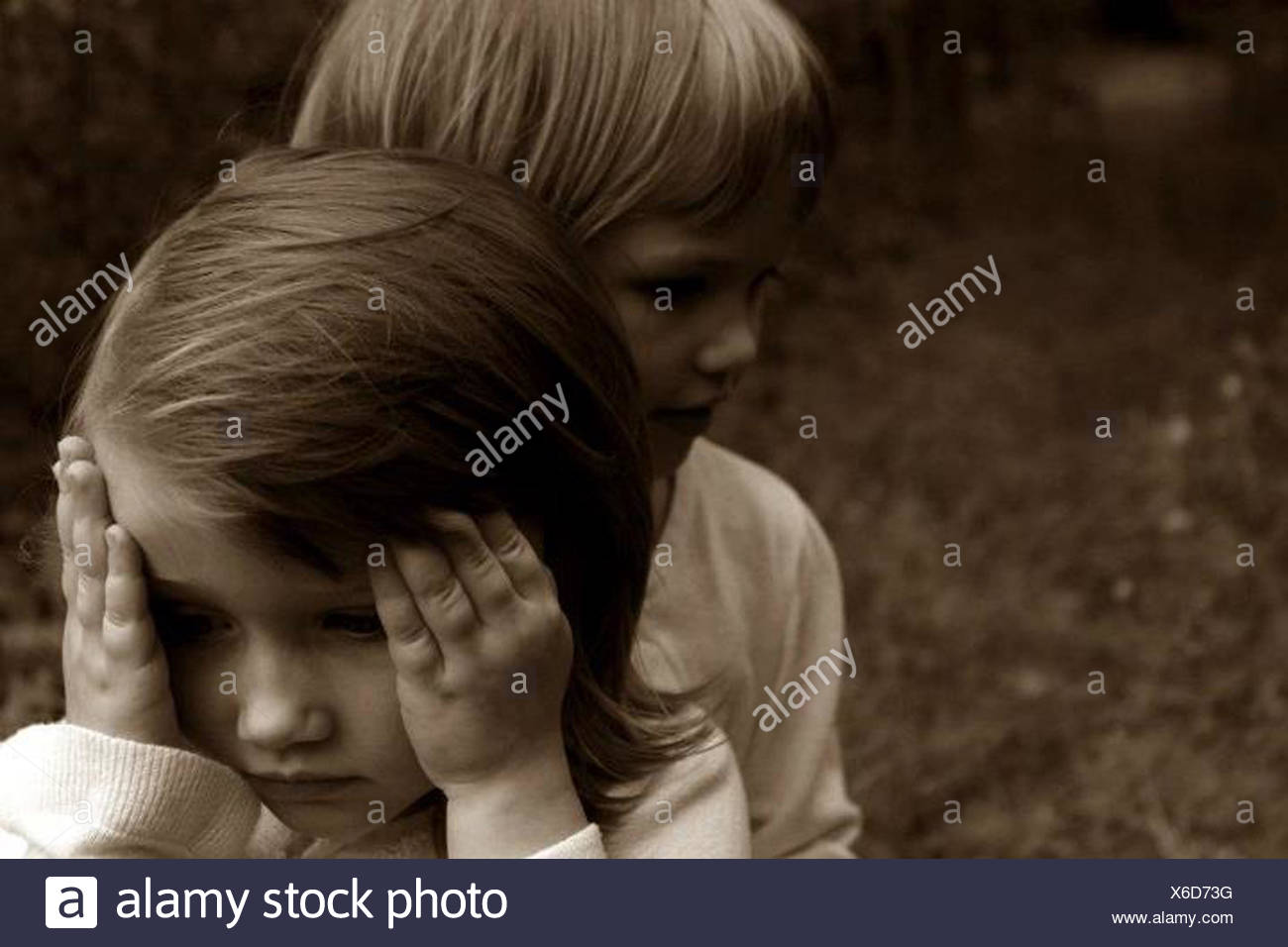 Two little girls outdoors Stock Photo
