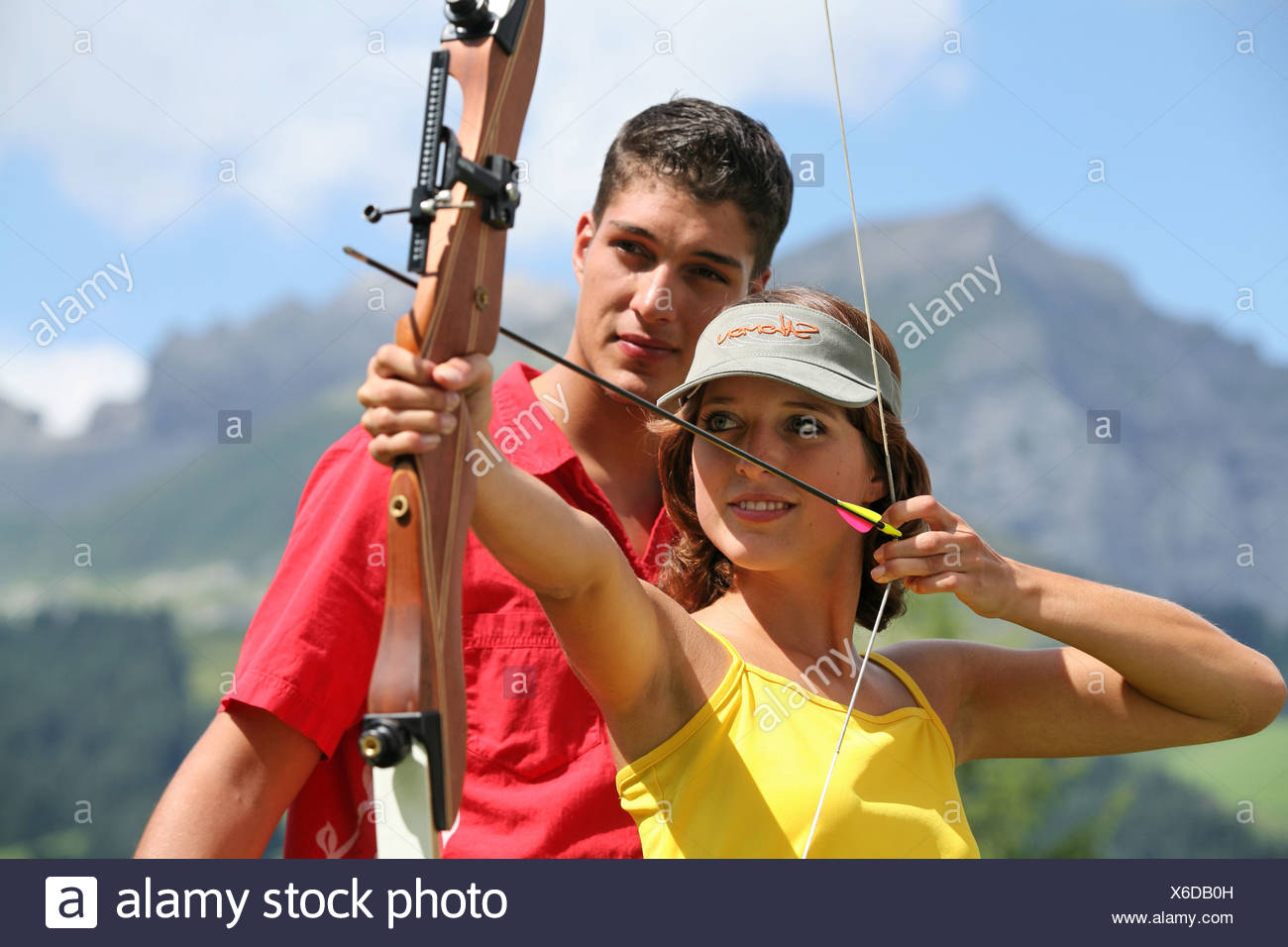 archery Outside curves arrow sighting Couple man woman weapon arms firearm sports precision sport shooter - Stock Image