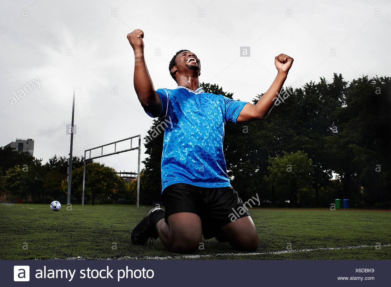 Soccer player celebrating goal - Stock Image