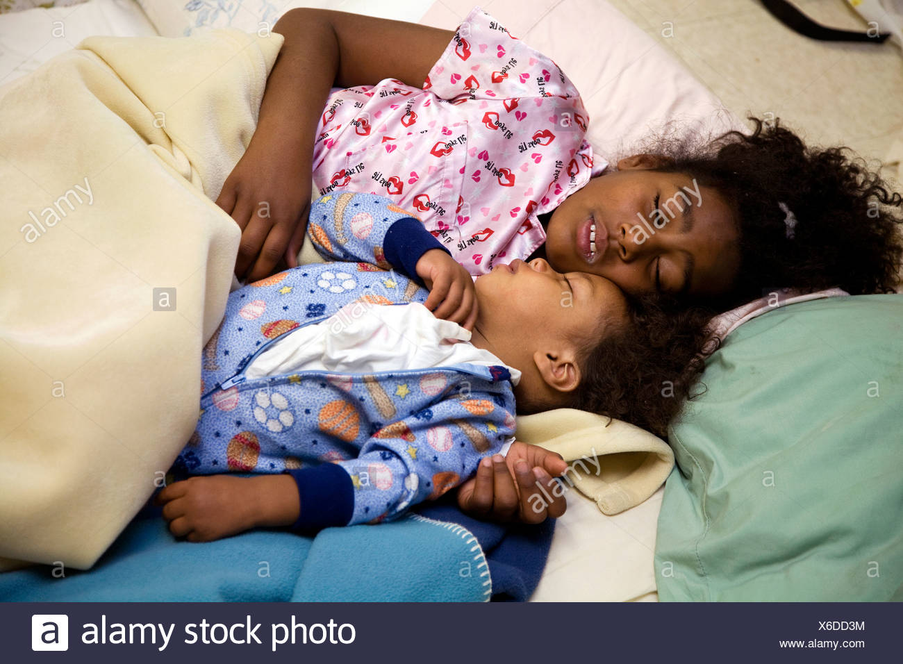 Selena Pina, a homeless mother of four, starts her day at 6am by coaxing her children to get up and ready for the day at United Stock Photo
