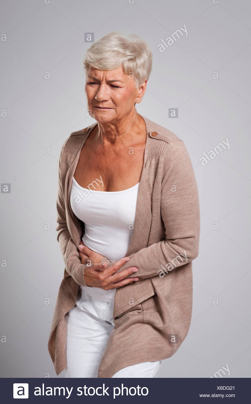 Older lady with a stomach ache - Stock Image