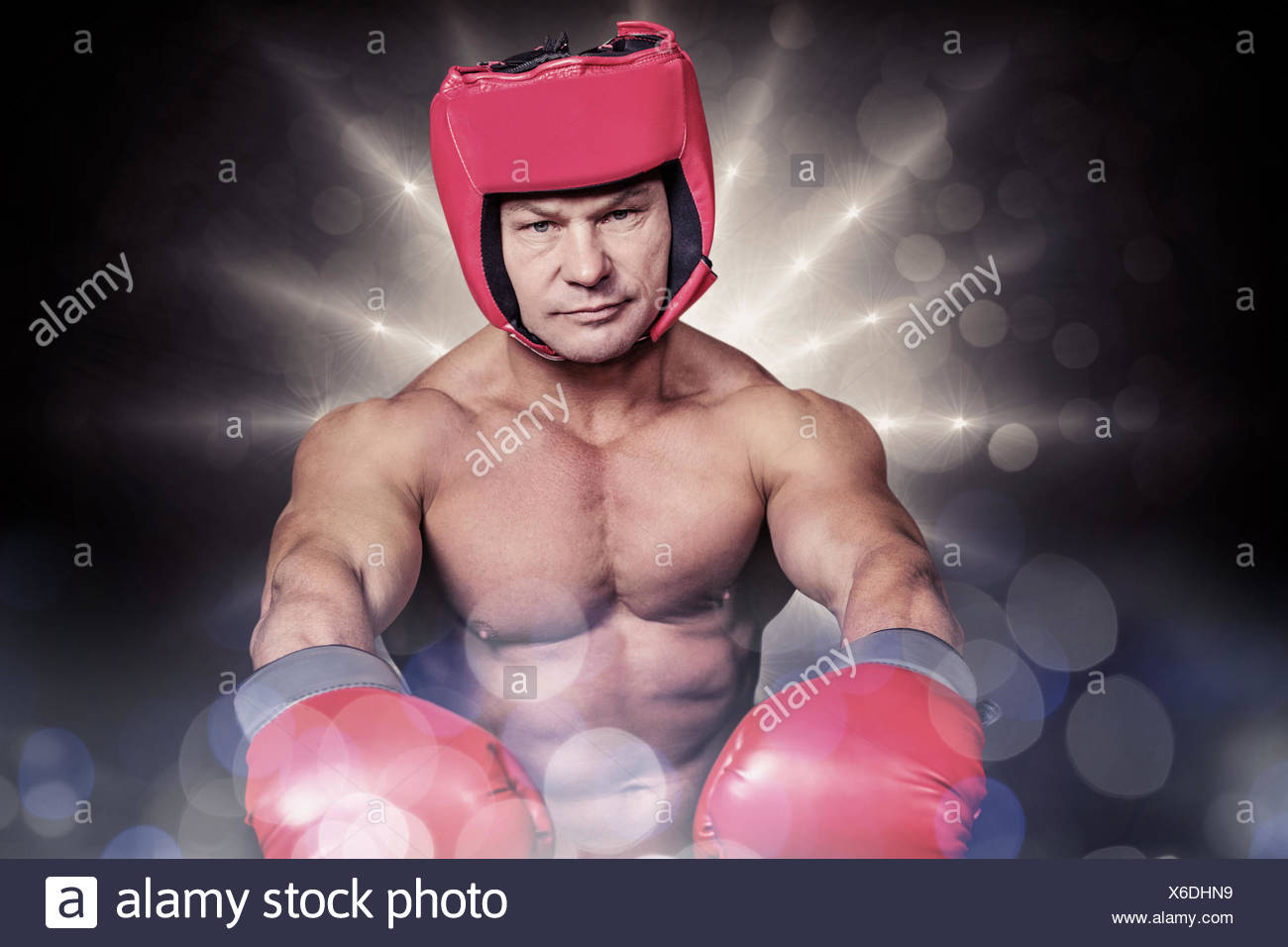 Composite image of portrait of boxer with red gloves and headgear - Stock Image
