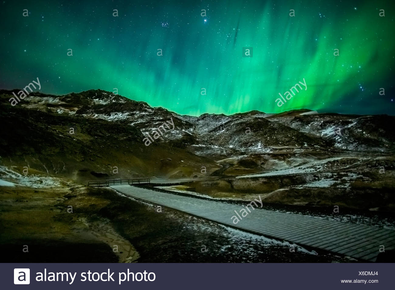 Aurora Borealis or Northern lights over geothermal area Krysuvik-Seltun, located on the Reykjanes Peninsula, Iceland - Stock Image