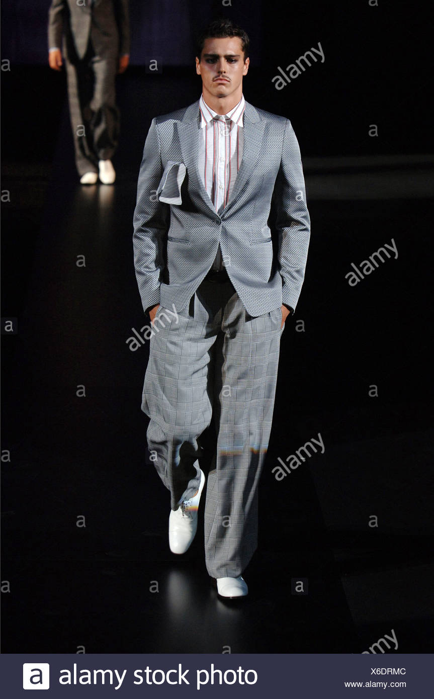 c4a7469fa Emporio Armani Milan Ready to Wear Menswear Spring Summer Brunette male  model walking down the runway