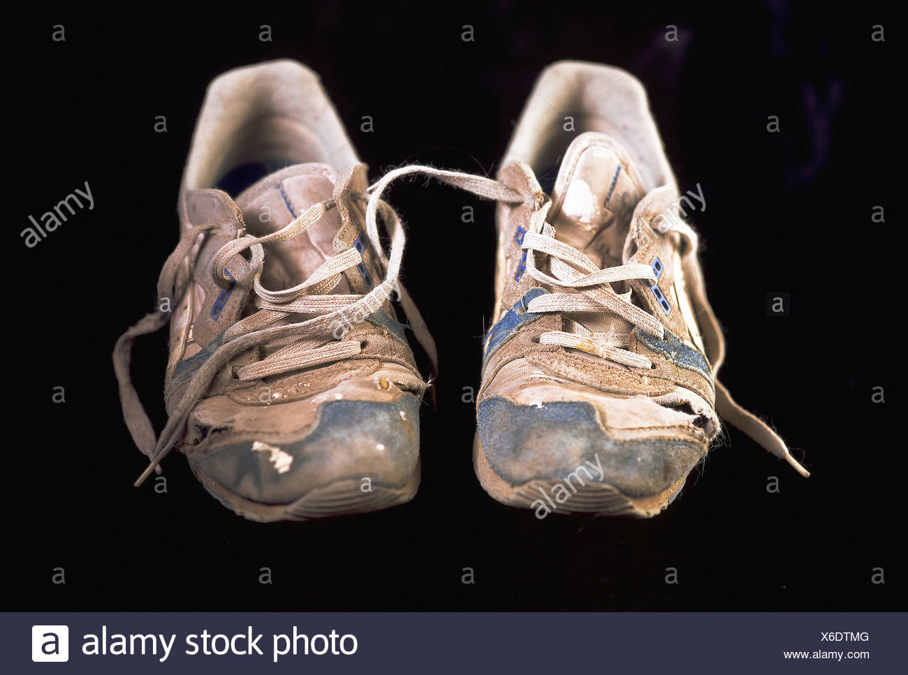 Worn-out sneakers - Stock Image