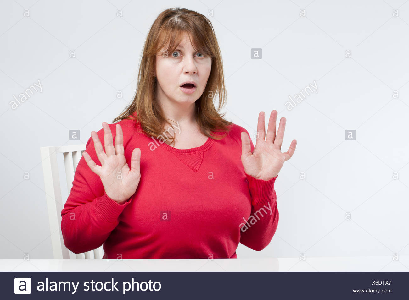 Frightened middle-aged woman. - Stock Image