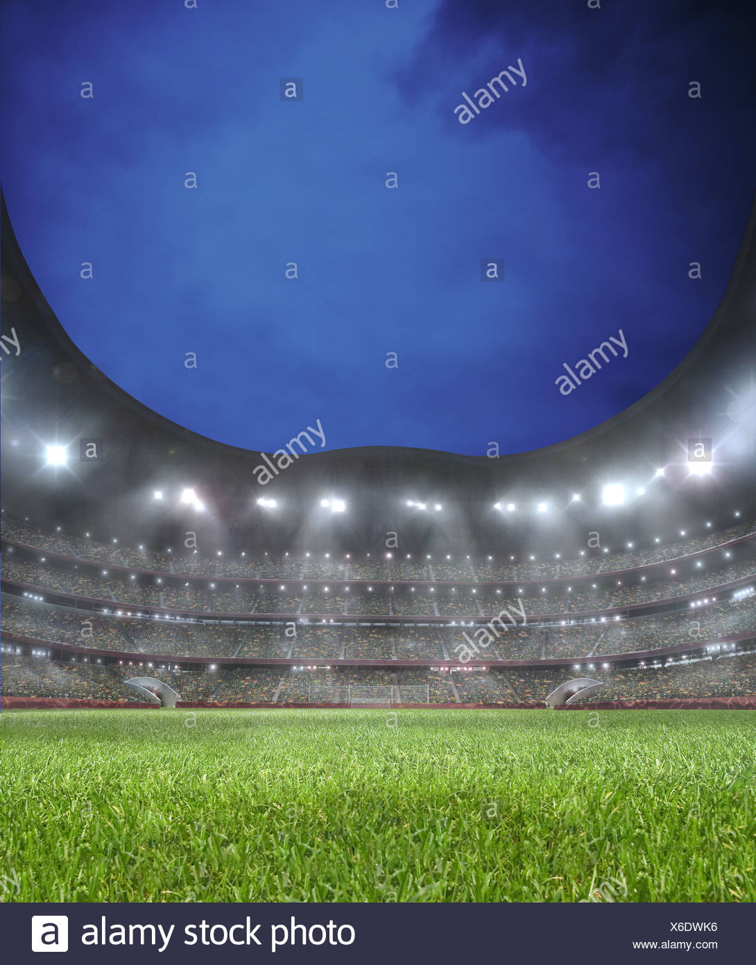 Lighted soccer stadium, lawn, grand stand - Stock Image
