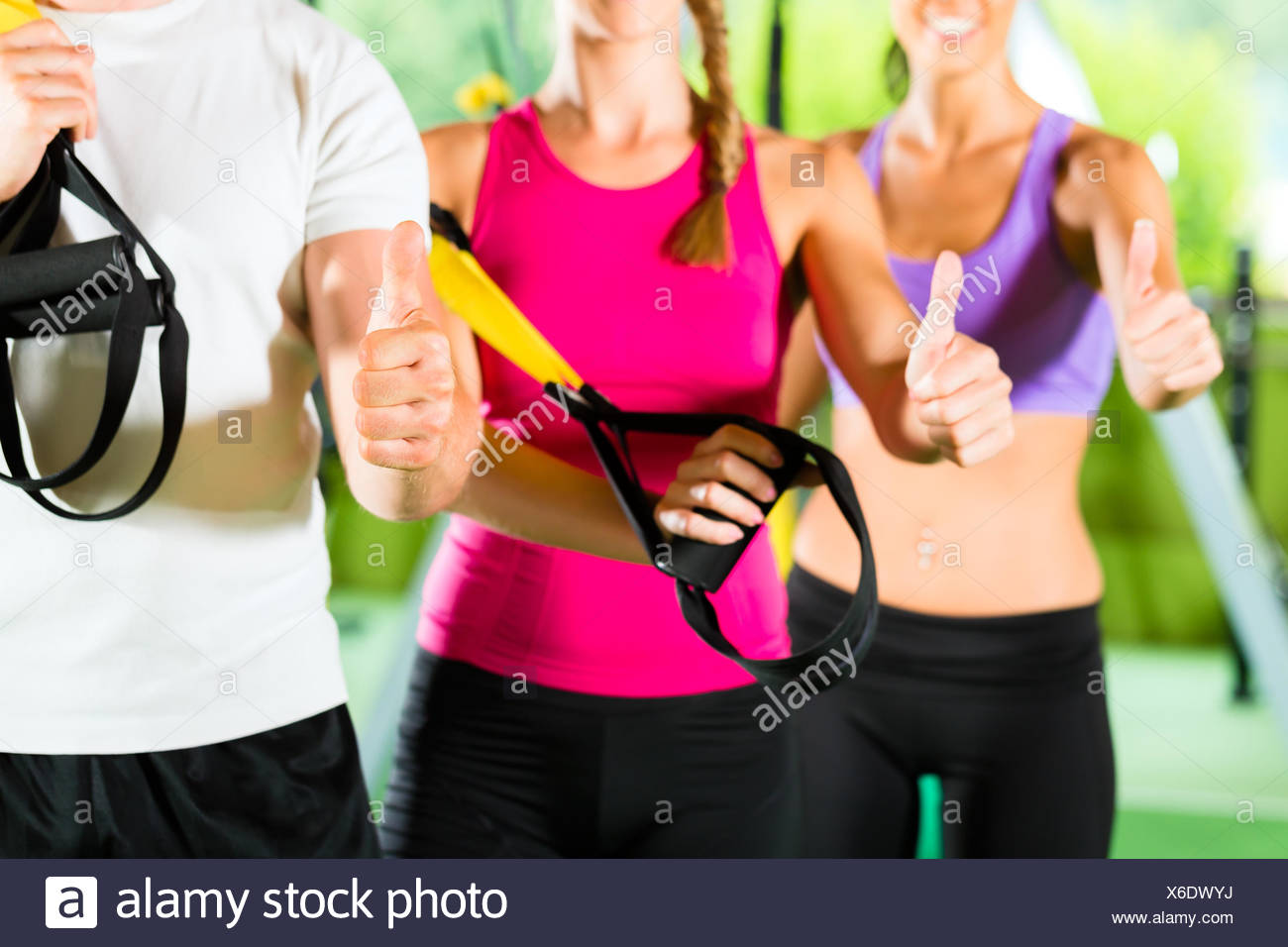 fitness center - happy people in front of the sport - Stock Image