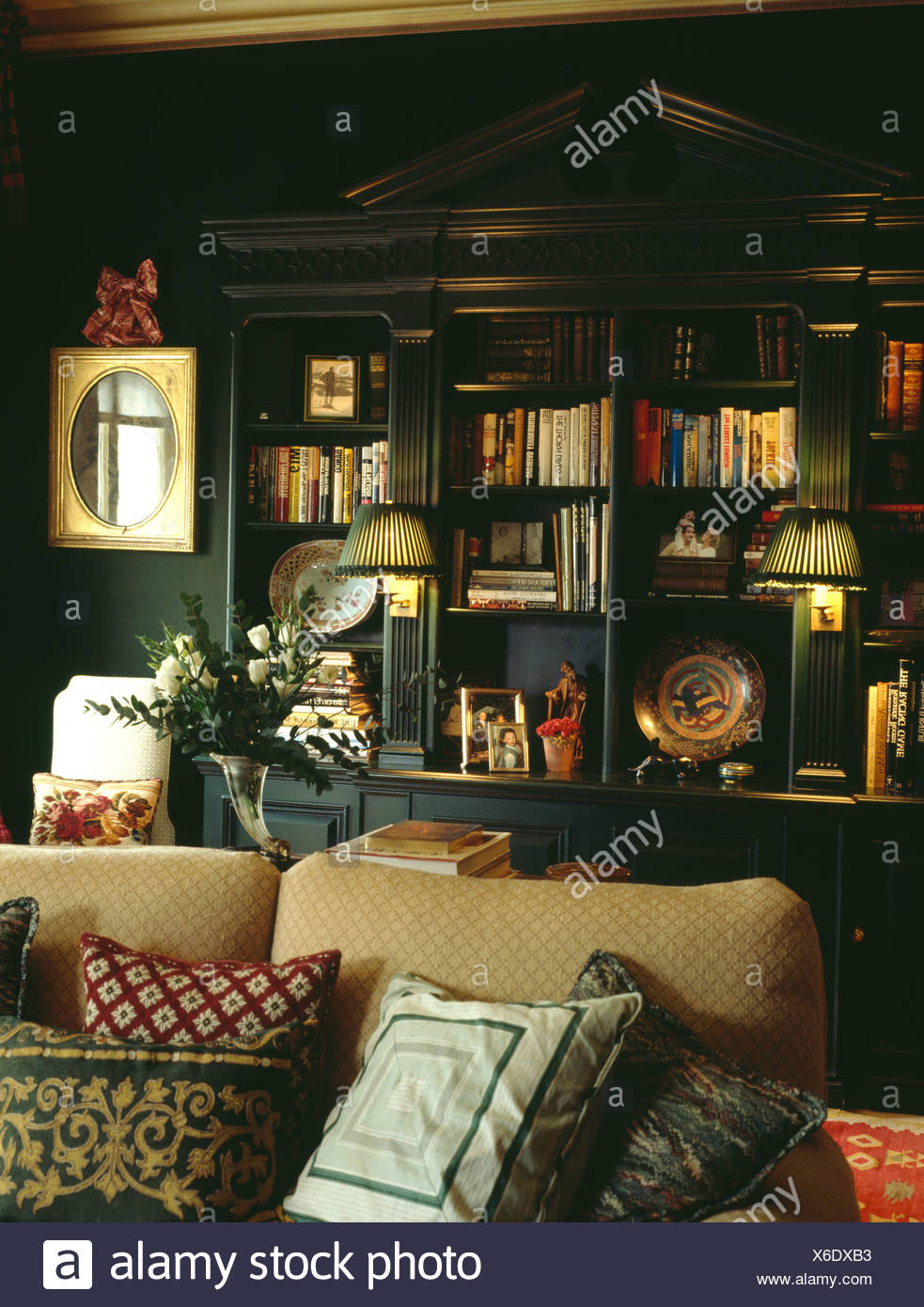 Astonishing Lighted Lamps On Fitted Bookshelves In Dark Green Living Download Free Architecture Designs Embacsunscenecom