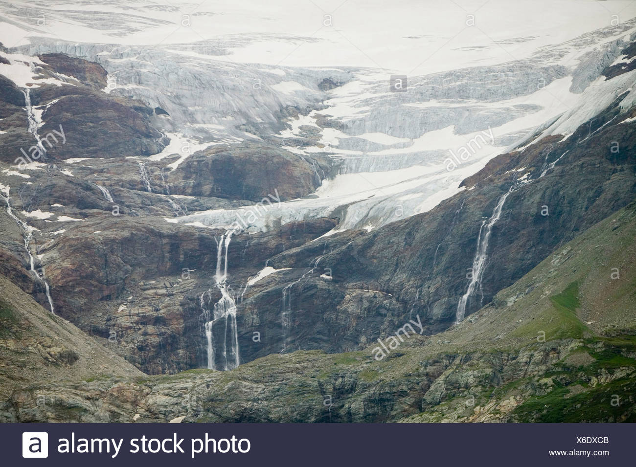 A rapidly receeding glacier above Alp Grum Switzerland below the Bernina Pass - Stock Image