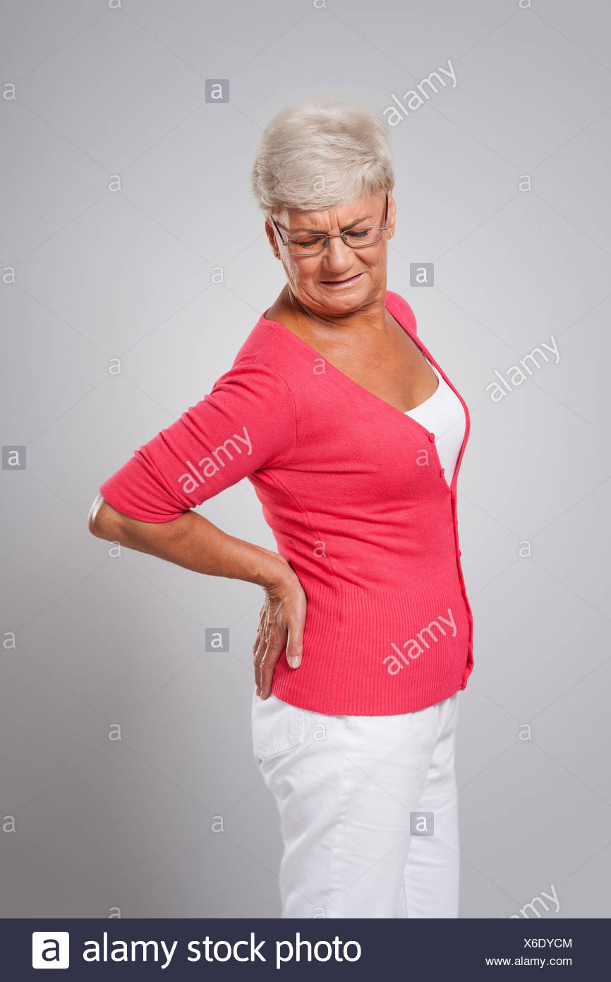 Lady with back pain - Stock Image