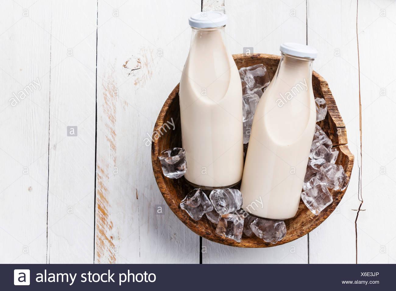 Milk in bottles on ice - Stock Image