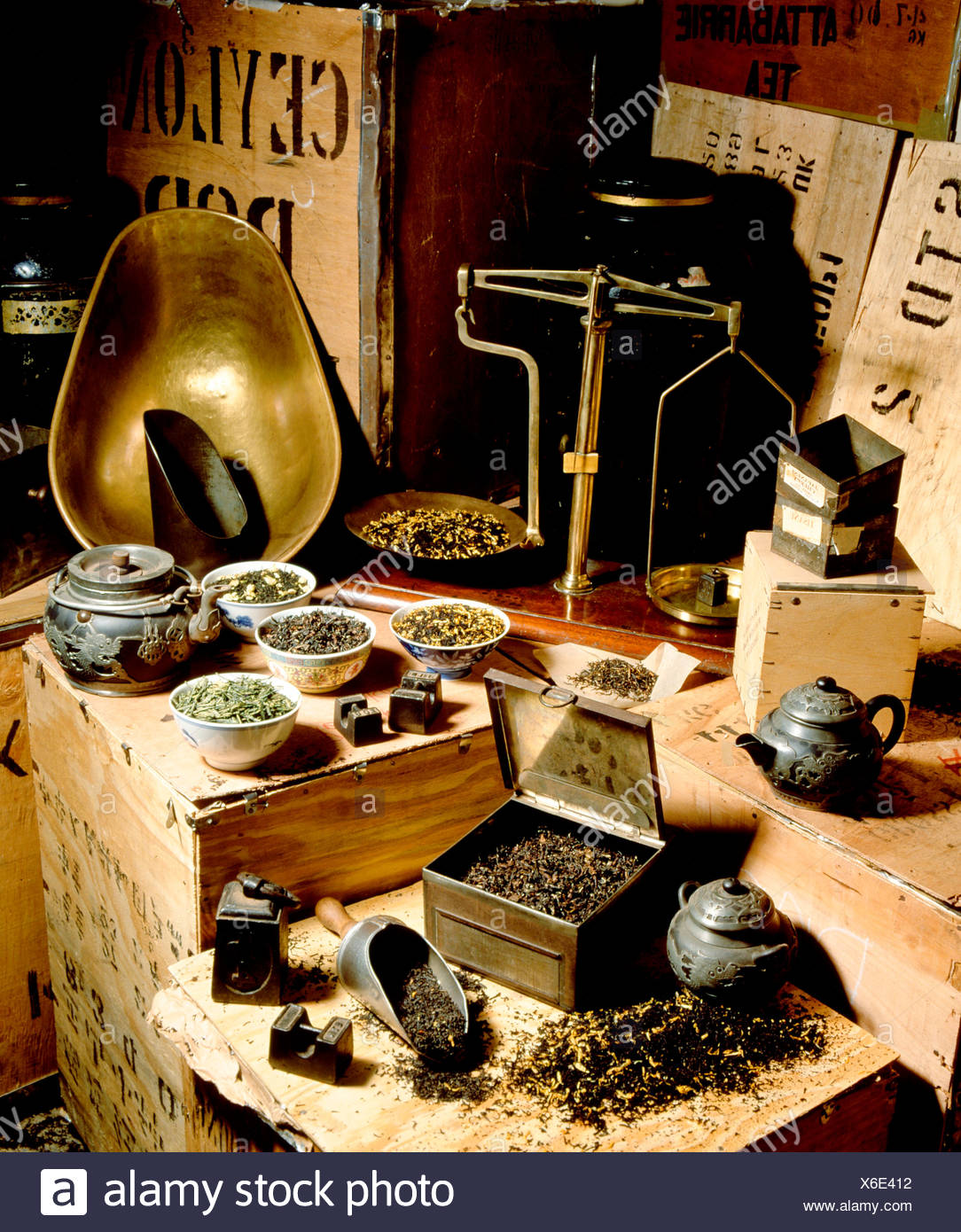 Still life with various tea leaves, tea boxes and teapots - Stock Image