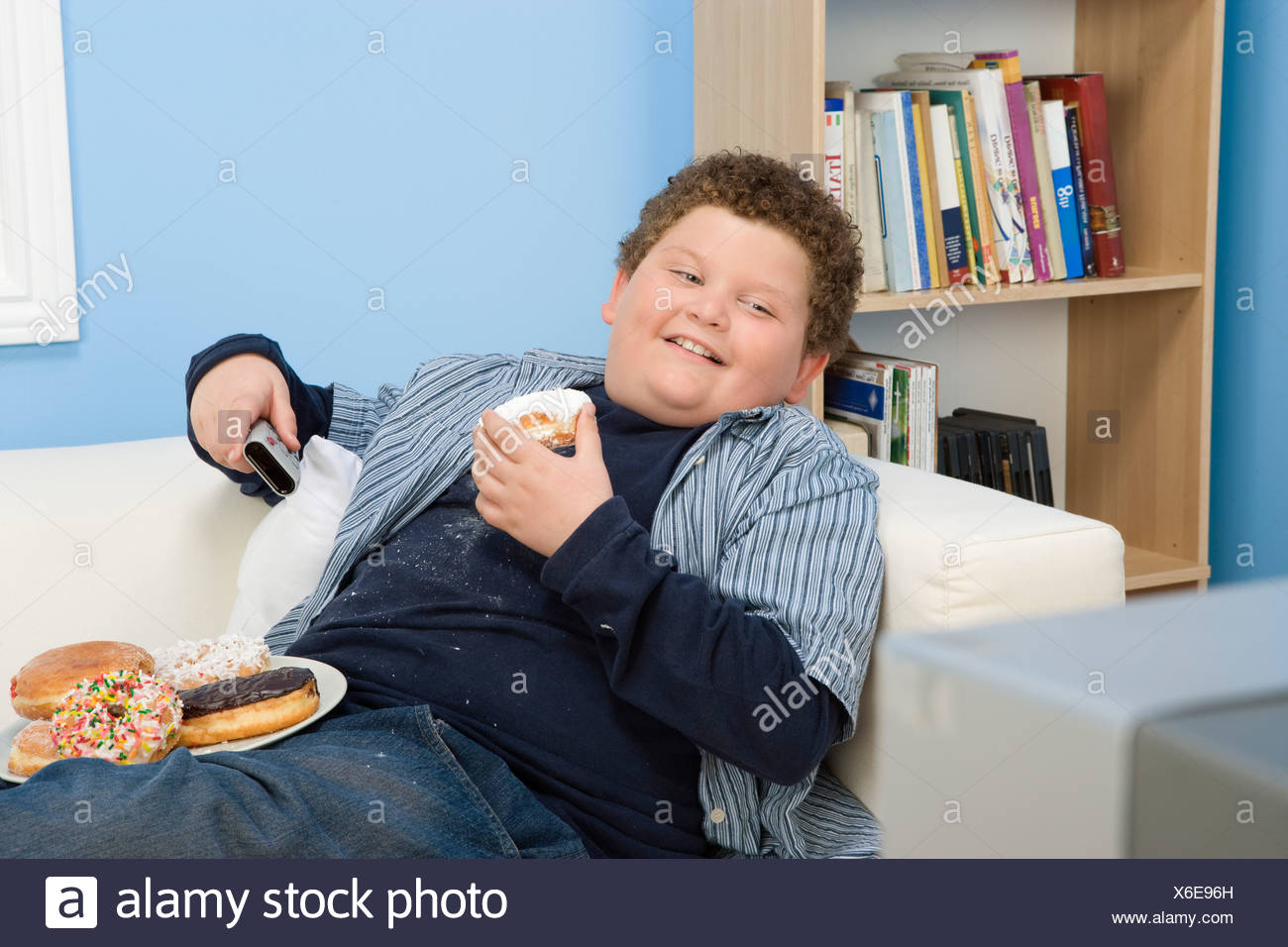 Boy Eating Donuts - Stock Image