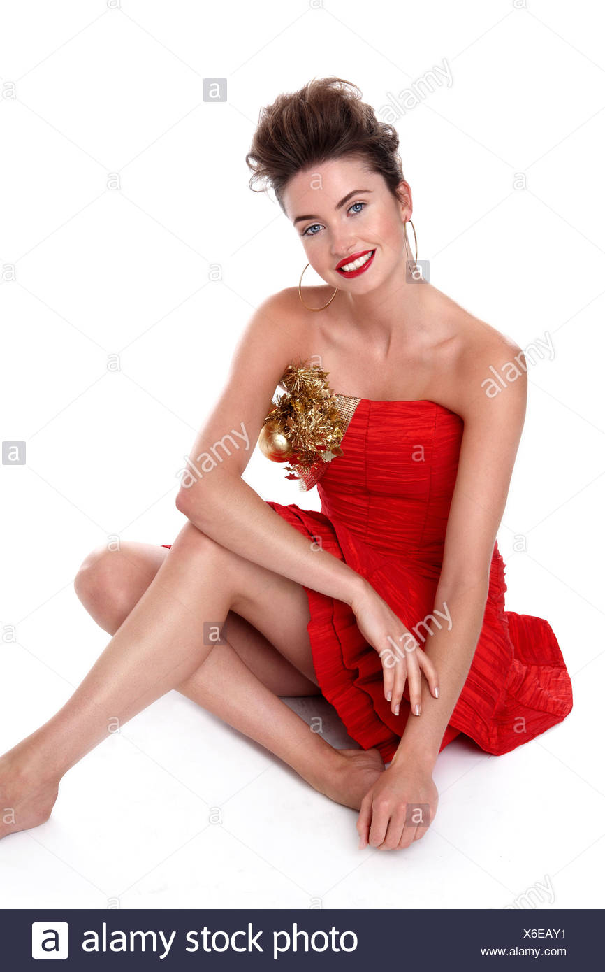 Young woman in red dress - Stock Image