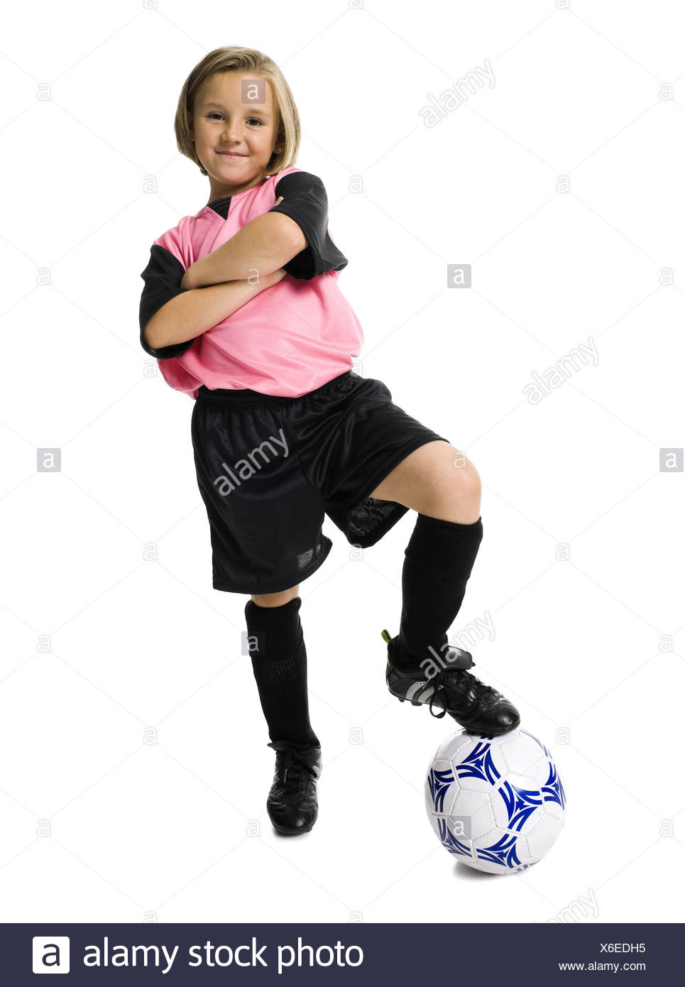 b498c33e0 Young girl in a soccer uniform with ball Stock Photo  279371825 - Alamy