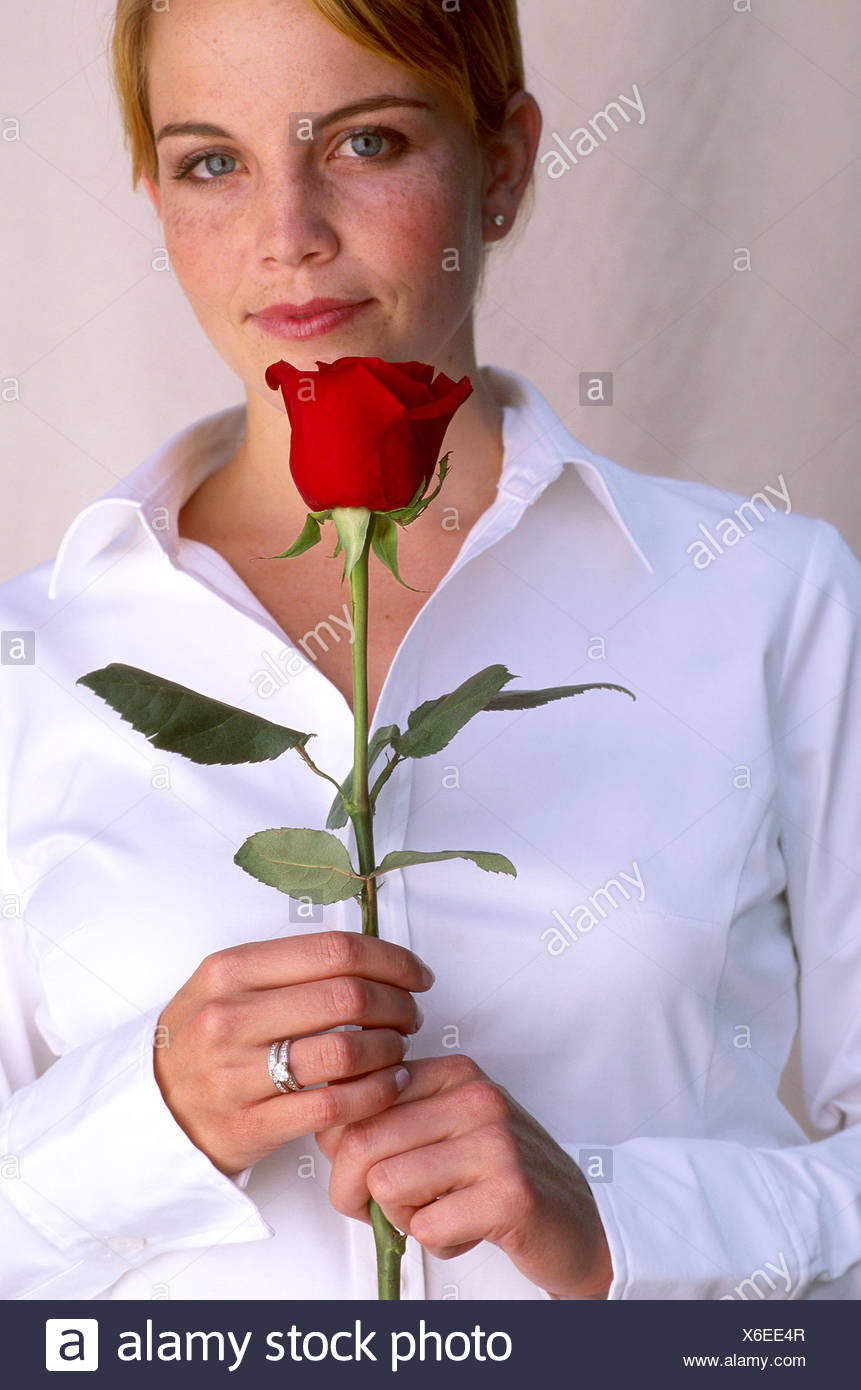 Woman with a single red rose - Stock Image