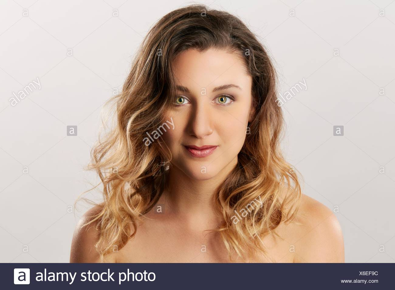 Young woman with bare shoulders - Stock Image
