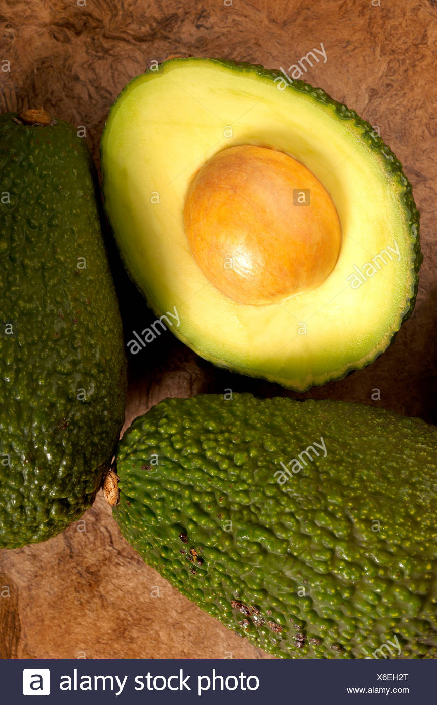 Avocados on textured background - Stock Image