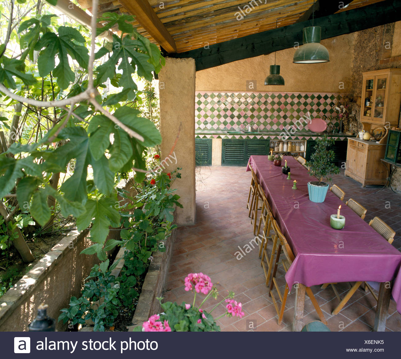 Purple Pvc Cloth On Table On Veranda Of French Country House With Pink Green Tiling In Outdoor Kitchen Stock Photo Alamy