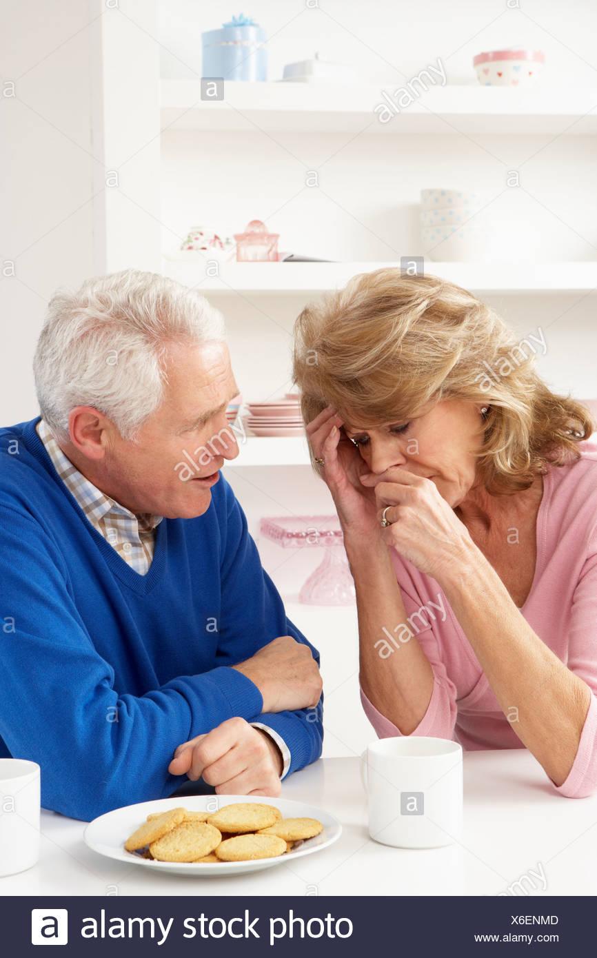 Senior Man Consoling Wife Stock Photo