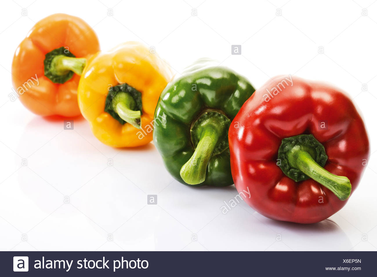 Fresh paprika in a row - Stock Image