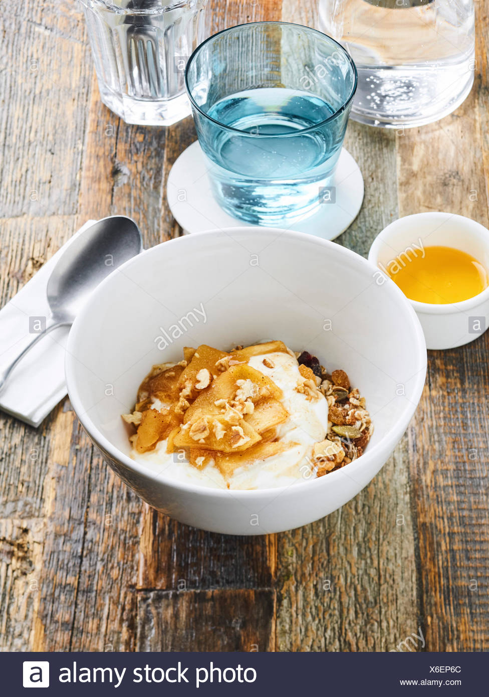 Granola with caramelised apples and yogurt, shot from above - Stock Image