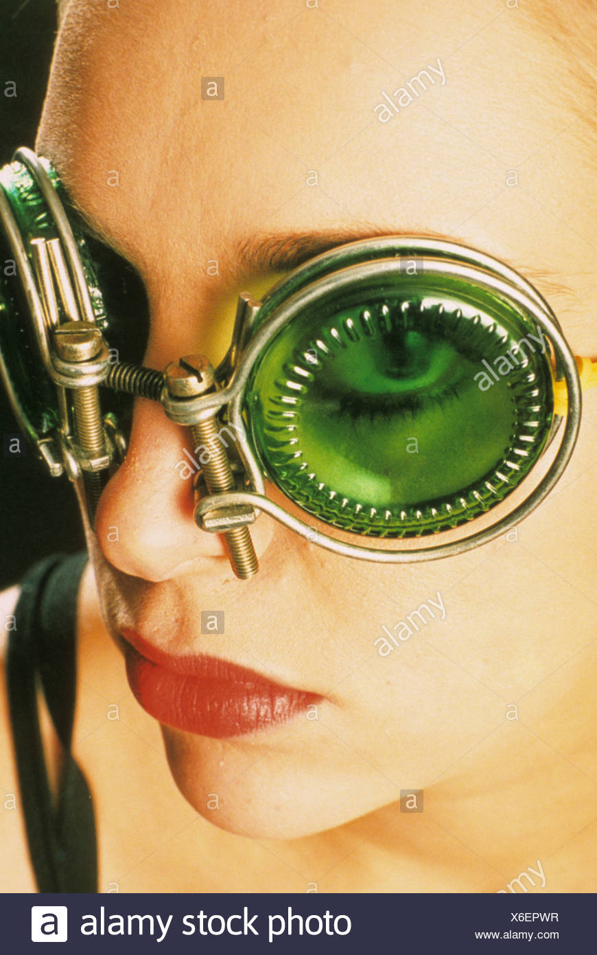 5e83315b6c Close up portrait of a woman wearing green tinted fashion googles - Stock  Image