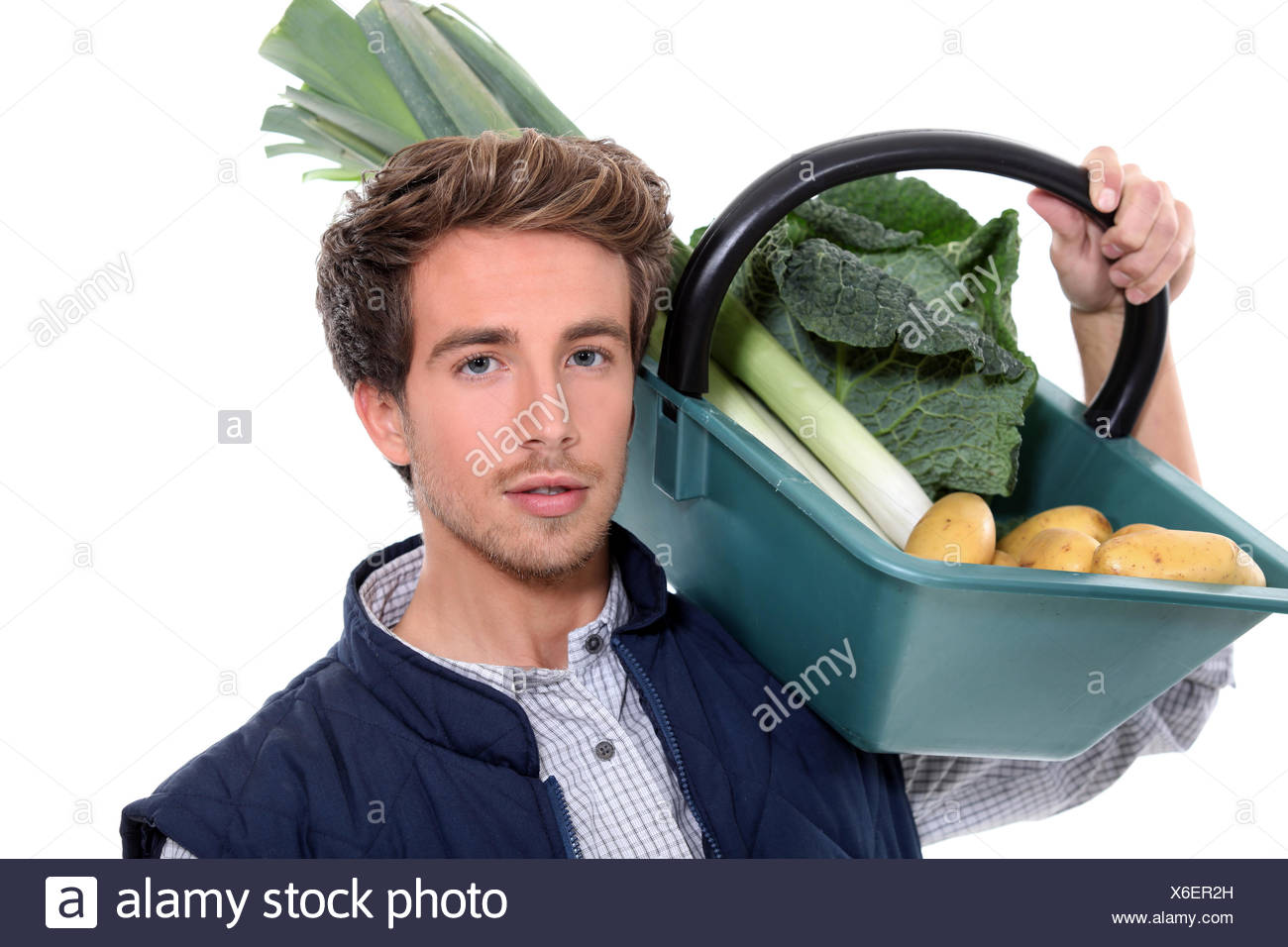 young farmer with a vegetables basket - Stock Image