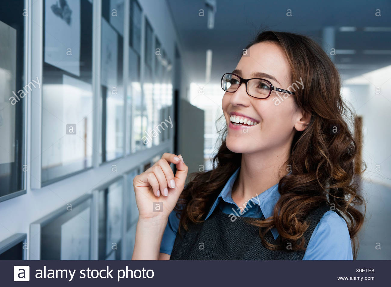 Germany, Bavaria, Diessen am Ammersee, Close up of businesswoman, smiling - Stock Image