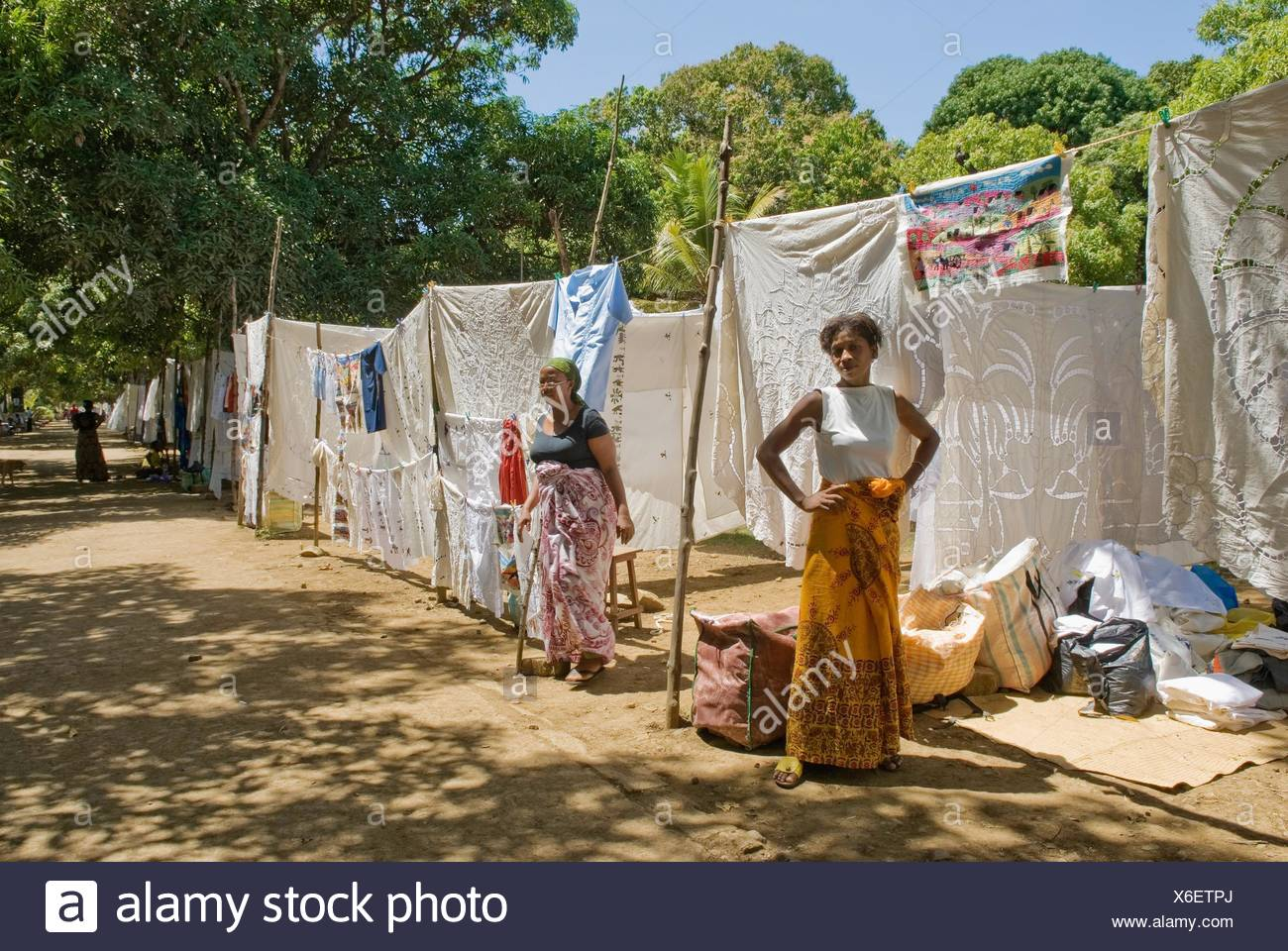 embroidered tableclothes market, Hell-Ville Andoany, Nosy Be island, Republic of Madagascar, Indian Ocean - Stock Image