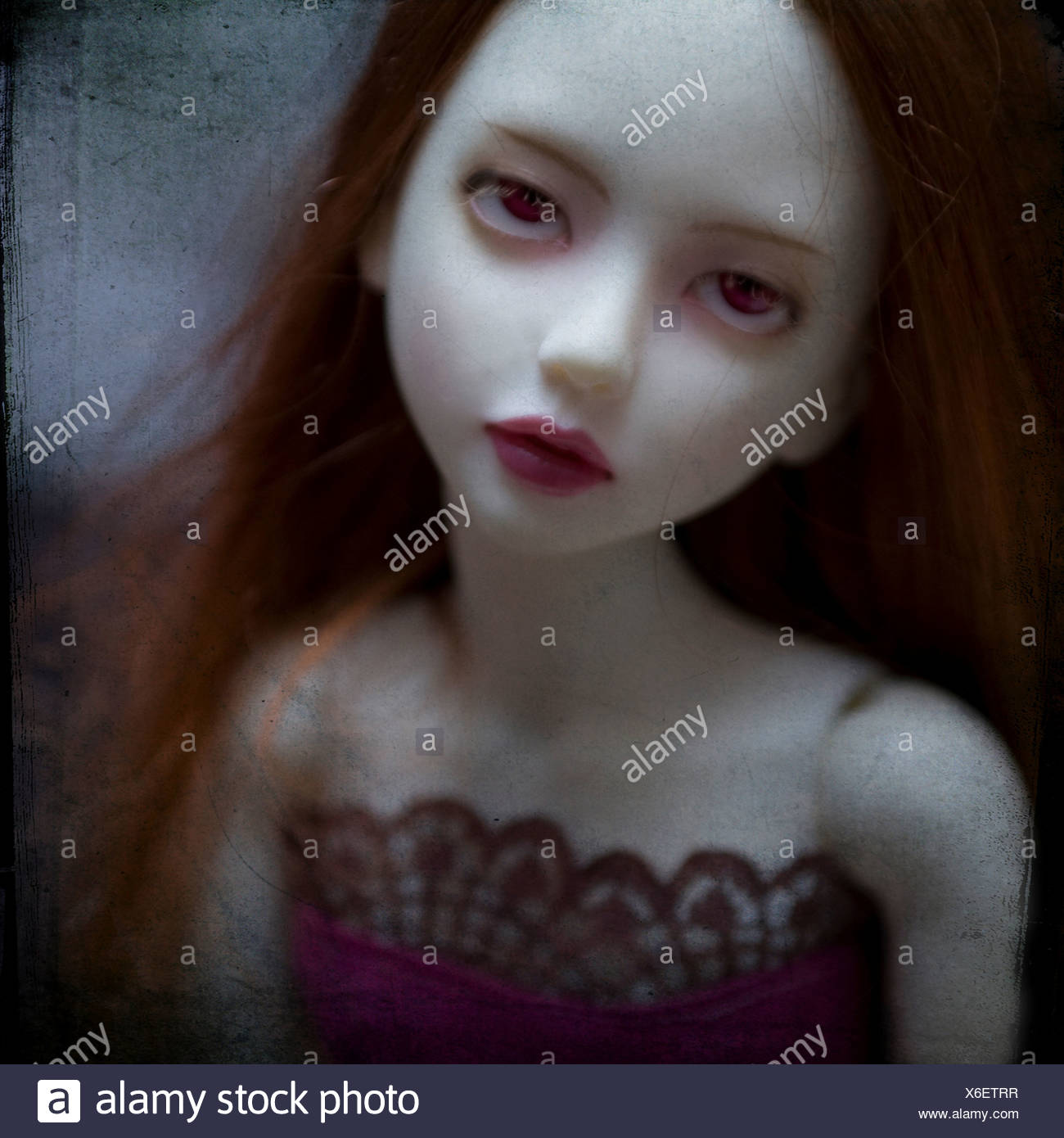Close up of dolls face looking upset - Stock Image
