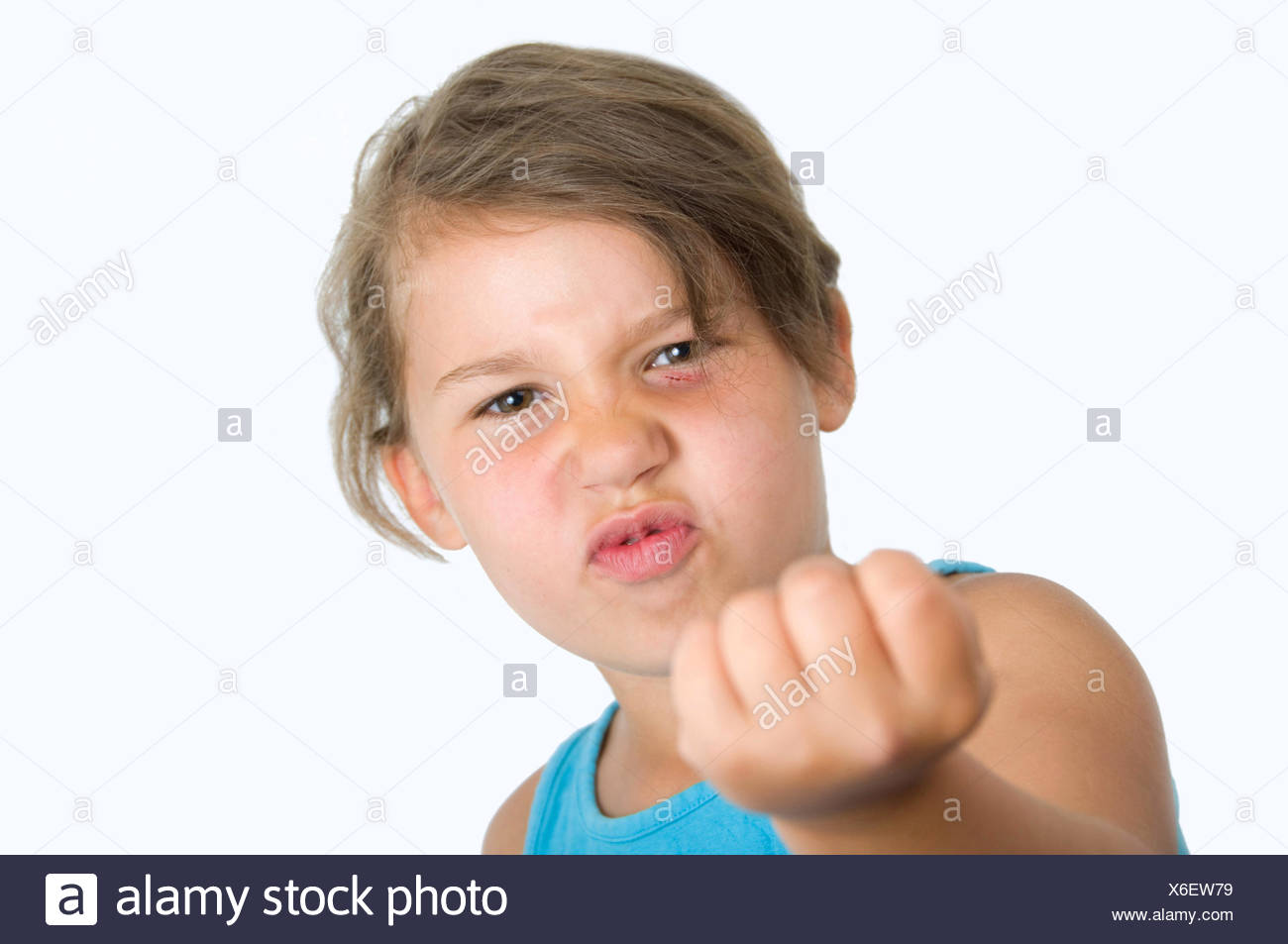 Girl with raised fist Stock Photo