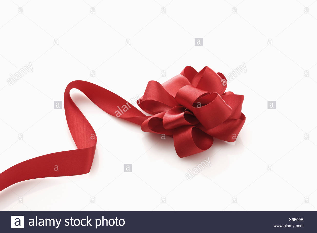 Red gift ribbon, elevated view - Stock Image