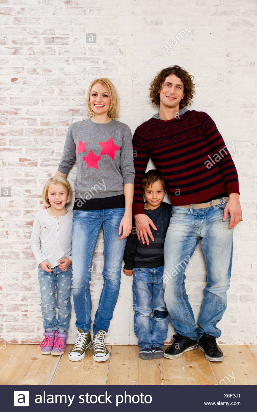 Studio portrait of couple with son and daughter Stock Photo