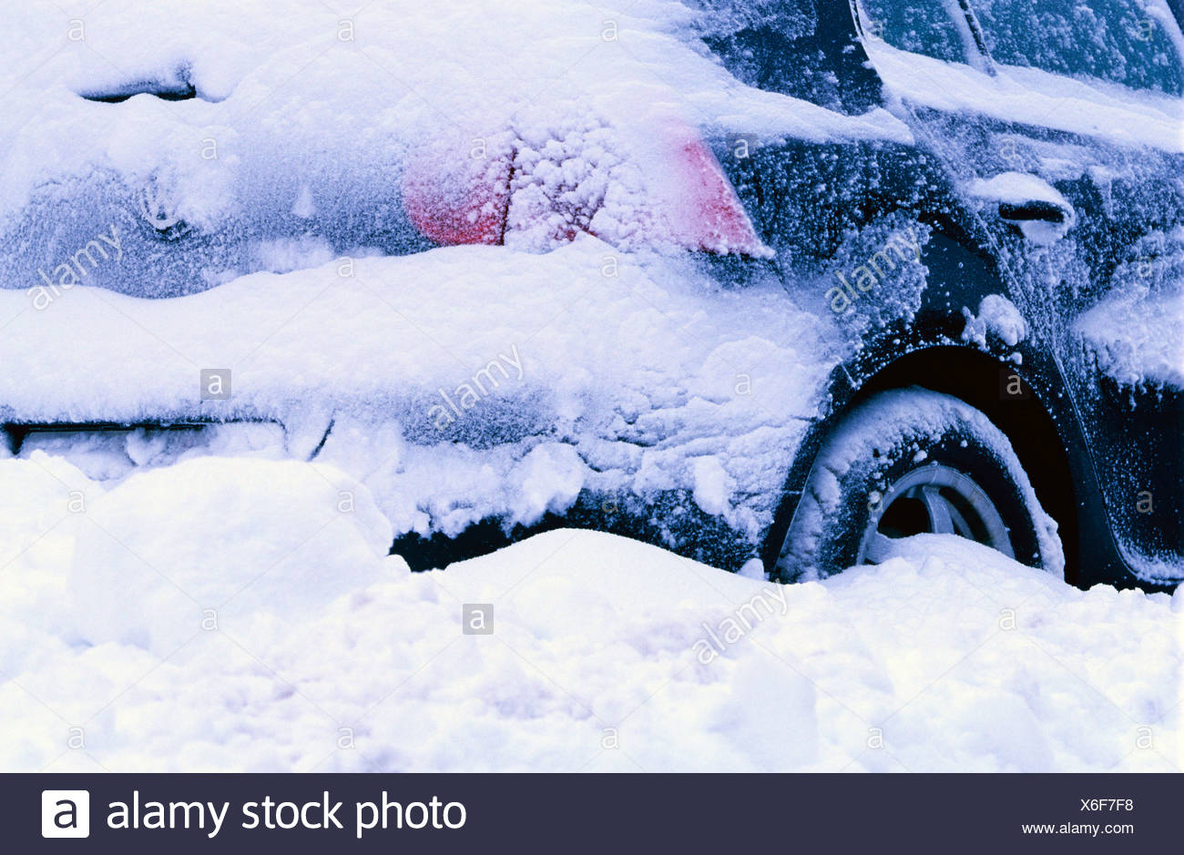 Snow-covered car - Stock Image