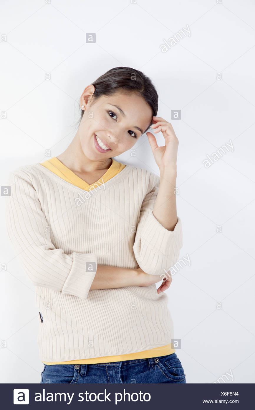 Young woman smiling - Stock Image