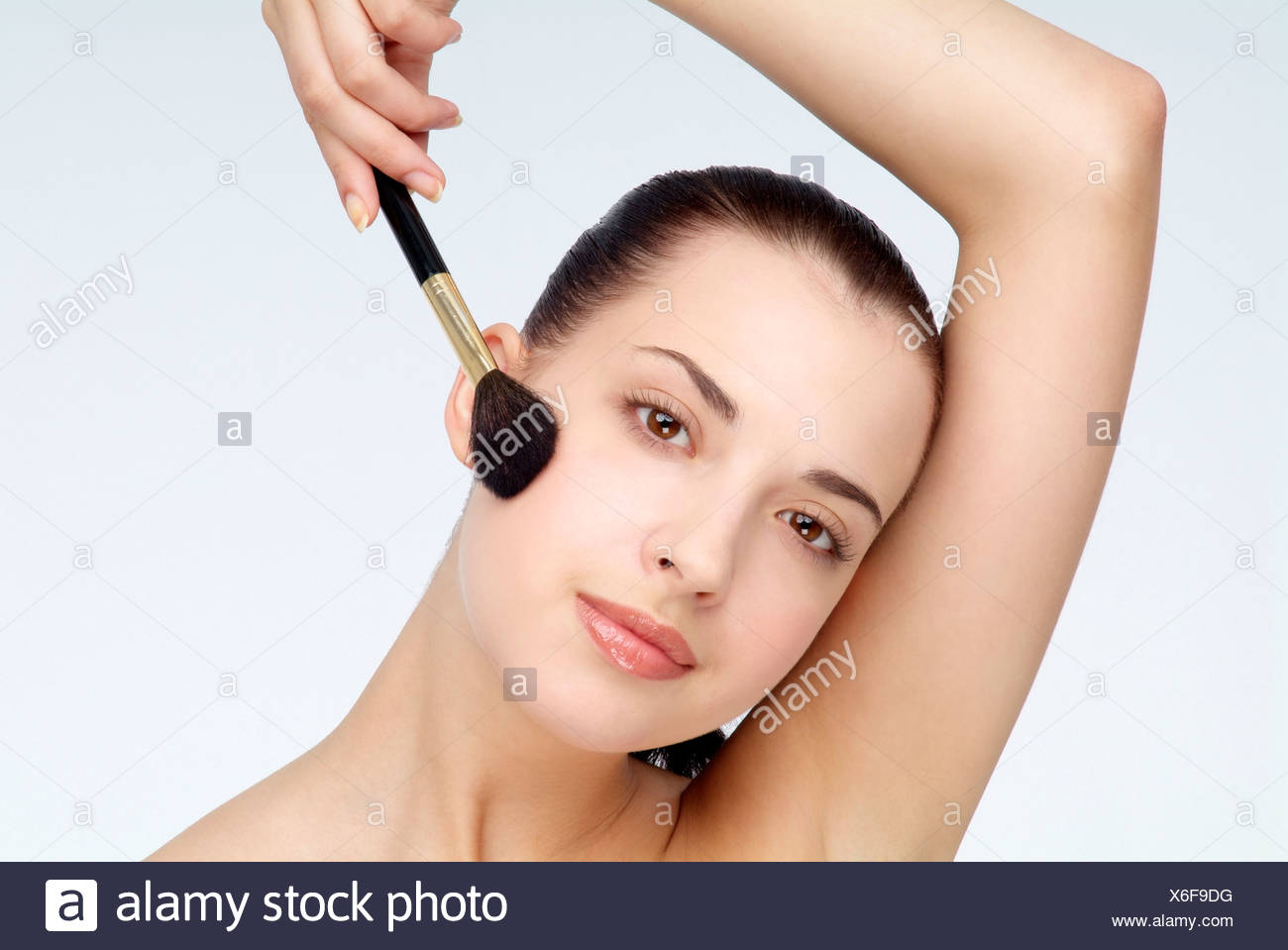View Of A Woman Using Foundation Brush Stock Photo 279390540 Alamy