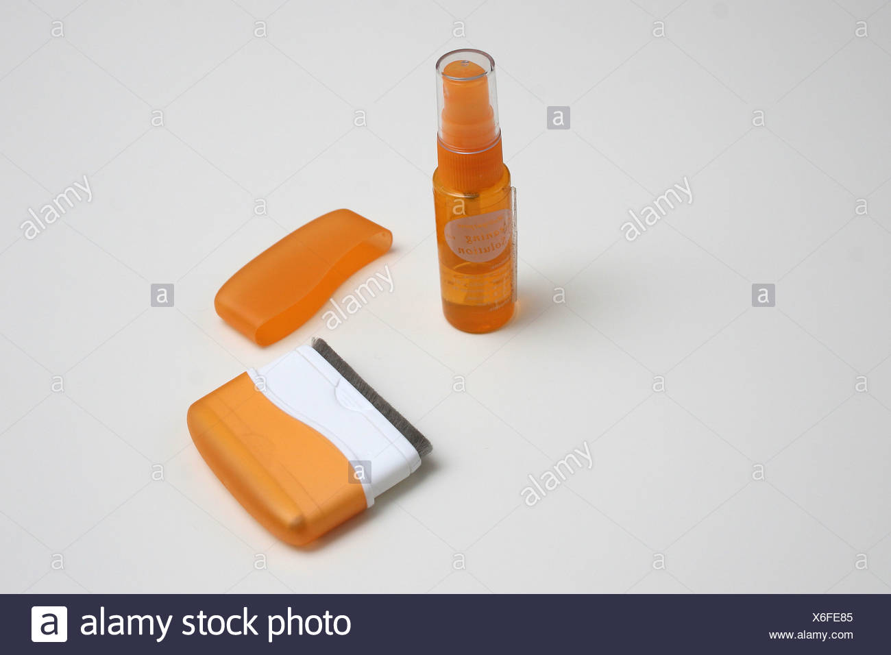 Computer screen cleaning solution and tools on white background - Stock Image