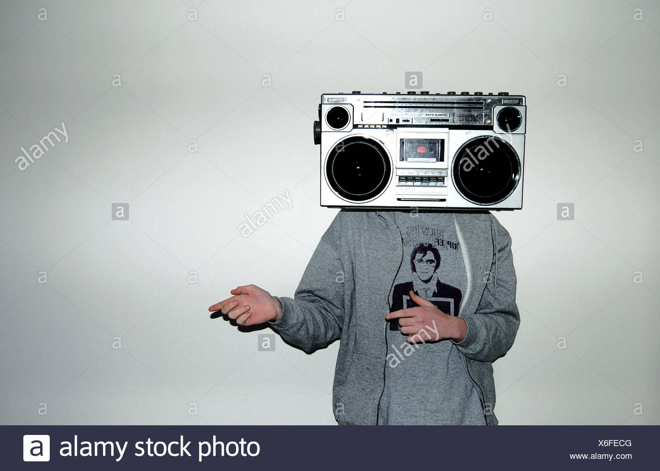 adolescent,listening to music,radio recorder - Stock Image