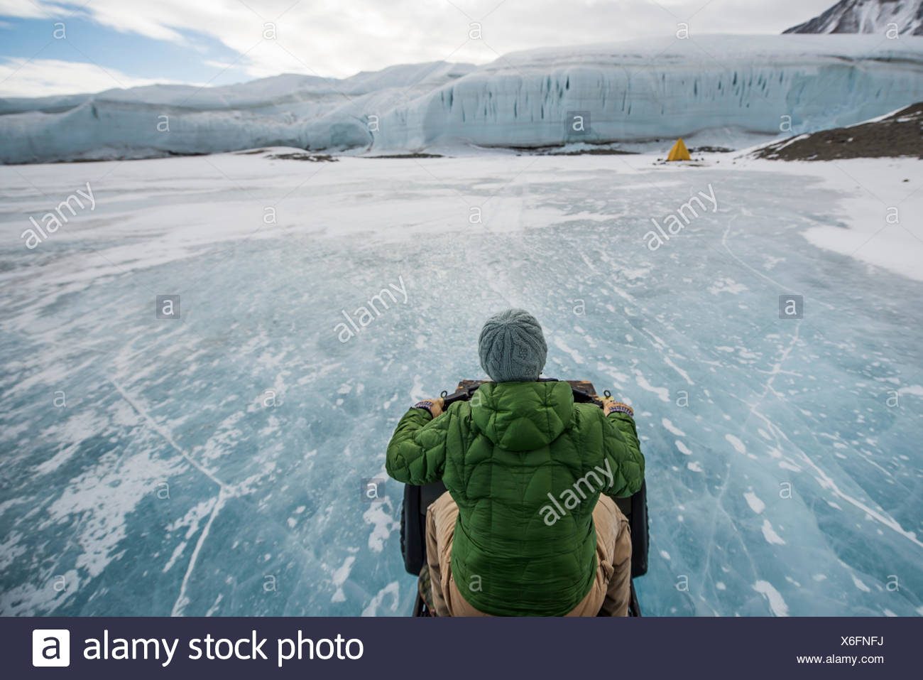 Driving an ATV across the frozen Lake Hoare in the Taylor Valley, Antarctica. - Stock Image