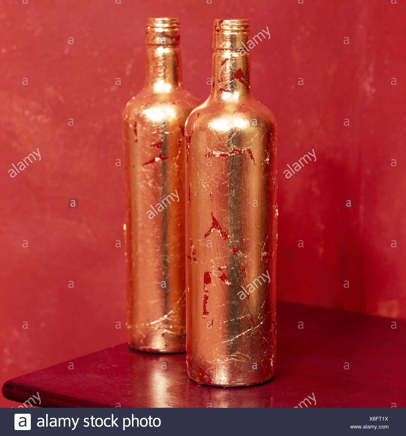 Close-up of hand gilded glass bottles - Stock Image