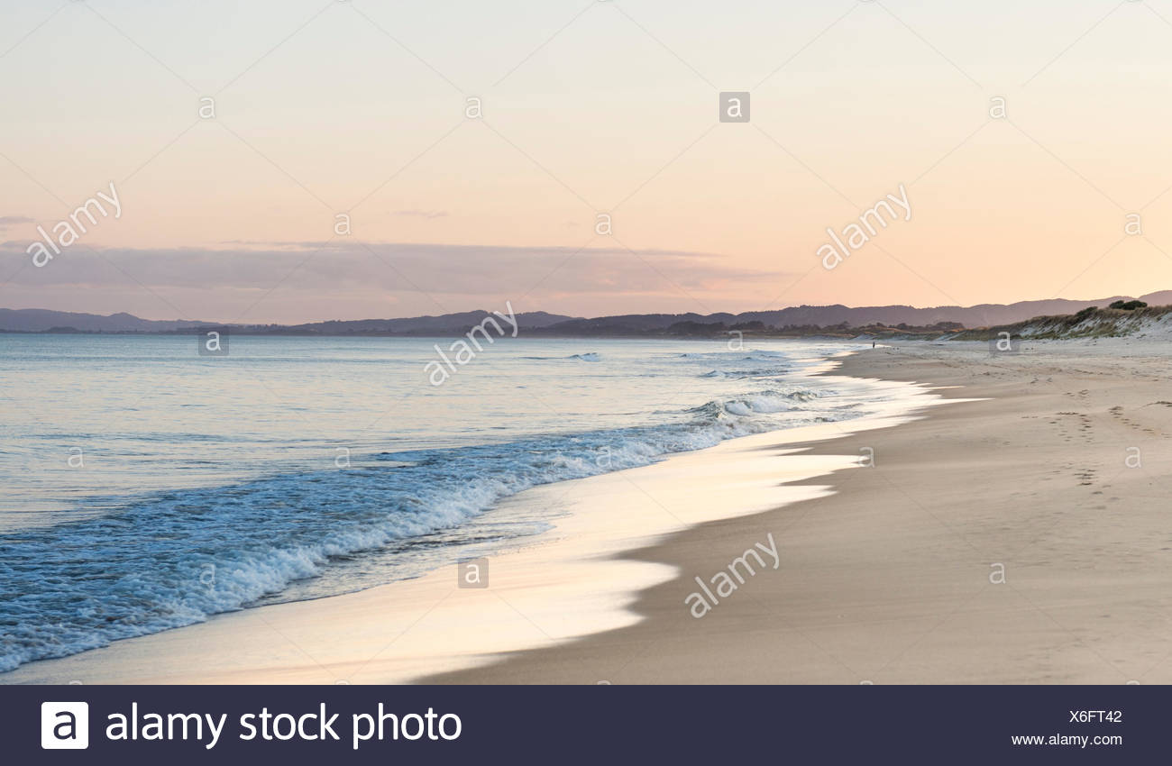Beach at sunset, Waipu, Northland, New Zealand - Stock Image