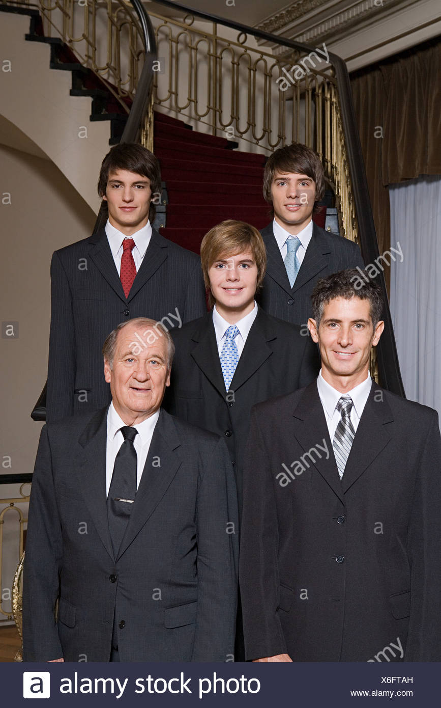 Male family members in suits - Stock Image